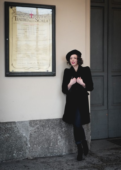 Lisette Oropesa in front of Teatro alla Scala in Giorgio Armani jacket, top and beret