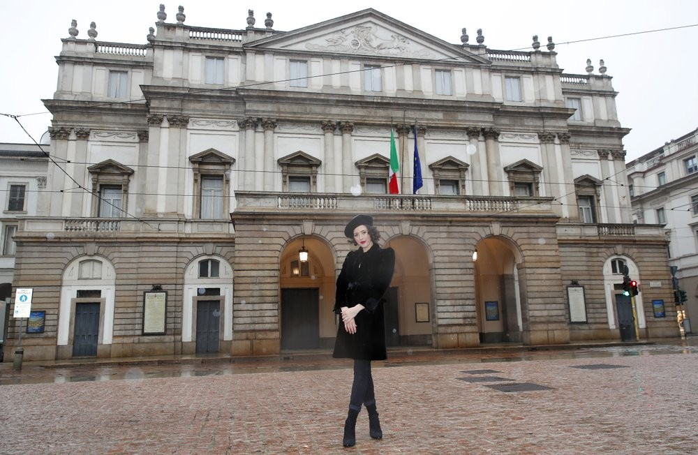 Lisette Oropesa poses in front of Teatro alla Scala in clothes by Giorgio Armani